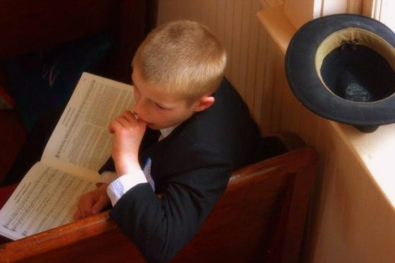 boy in churchhat
